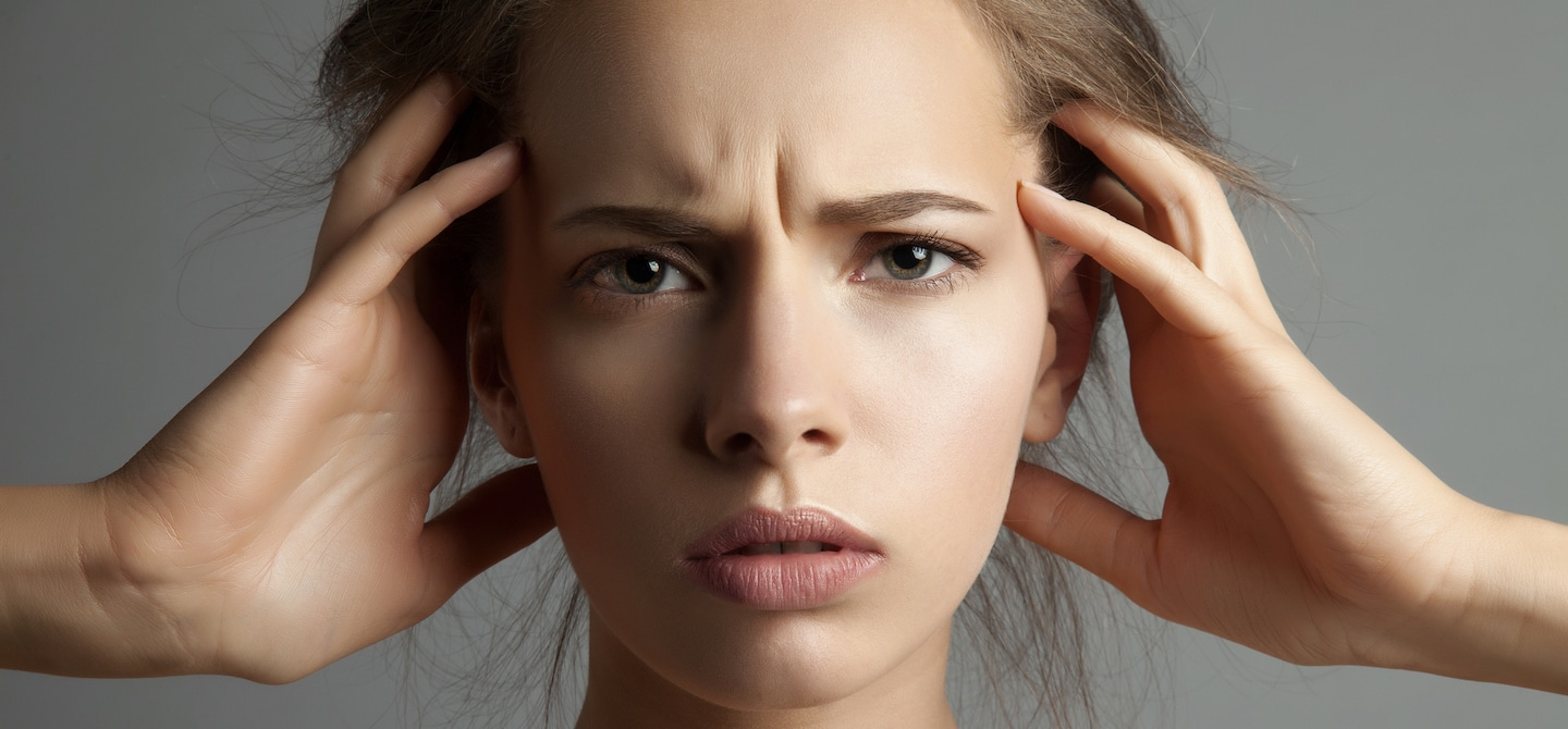 Stressed woman touching face