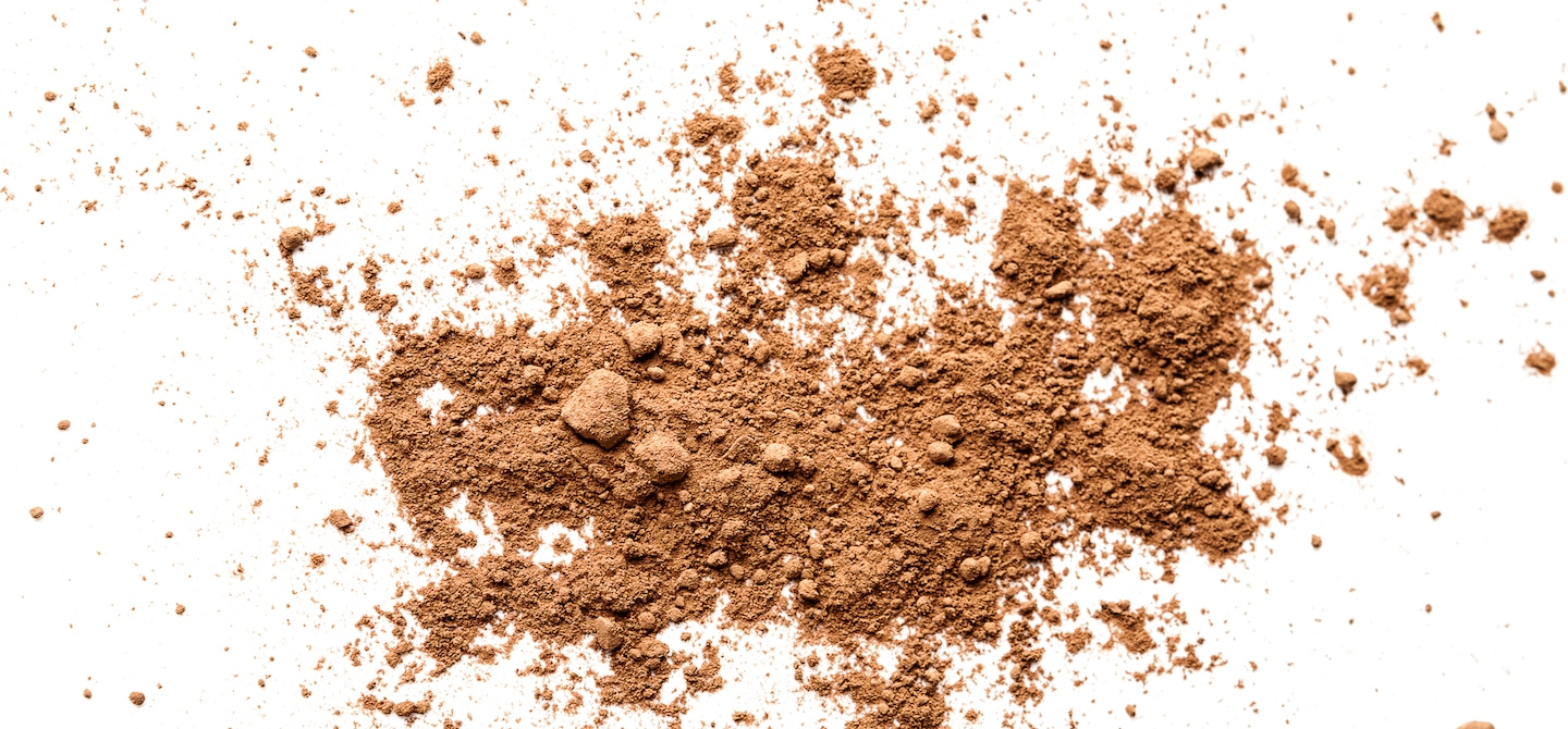 Brown powder splayed out on white background