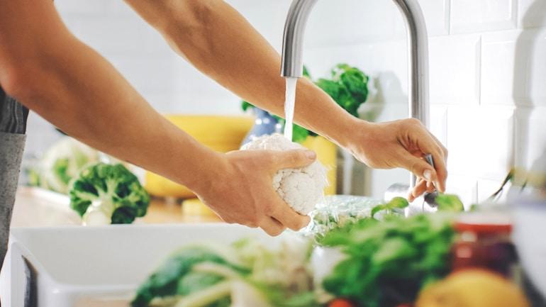 Woman rinsing cauliflower to make rice