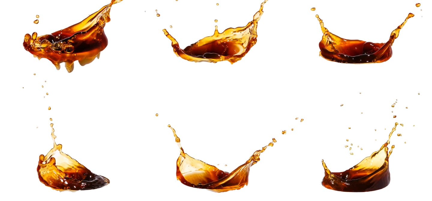 6 drips of coffee on white background