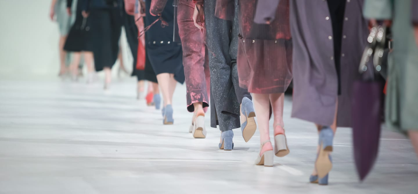 Shot of models' shoes and lower bodies walking the runway at NYFW
