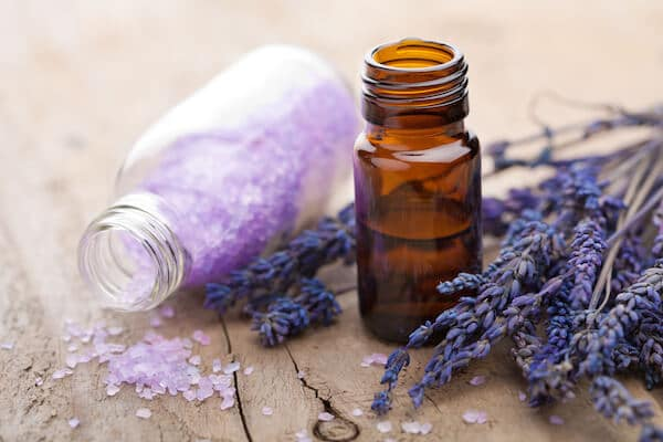 Lavender aromatherapy essential oils, bath salts and fresh lavender.