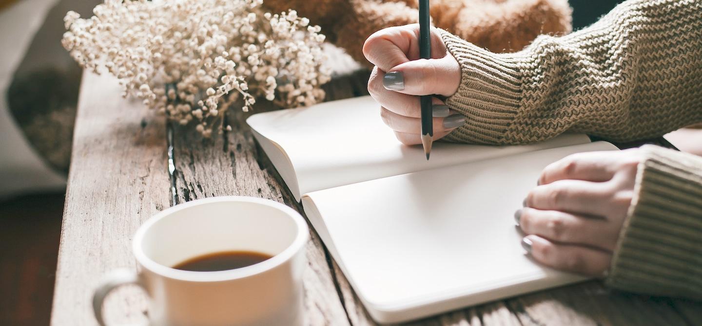 Woman gratitude journaling