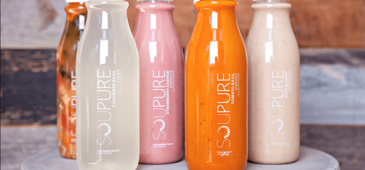 Brightly colored Soupure bottles for a soup cleanse