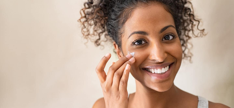 Woman applying retinol in her twenties