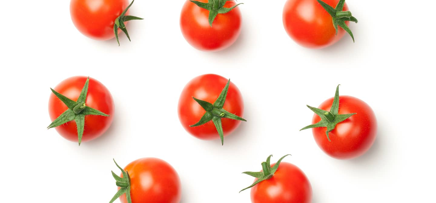 Bright, ripe tomatoes - which have lectic - on white background