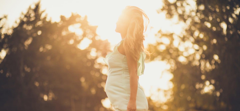 Pregnant woman getting fresh air outside before sundown
