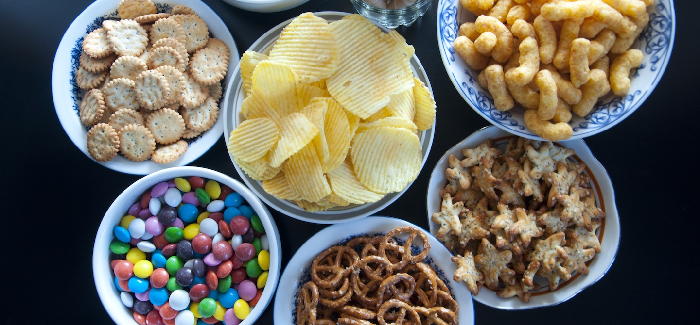 Table full of bowls of junk food, which have unhealthy food additives