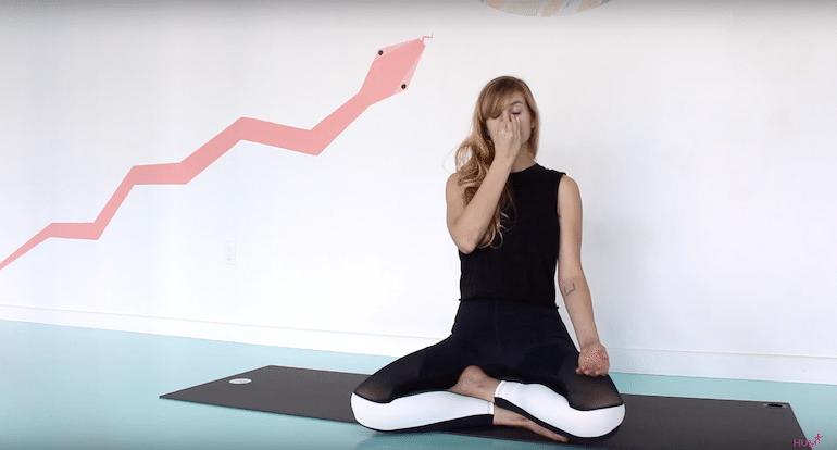 Yoga teacher demonstrating alternate nostril breathing exercise