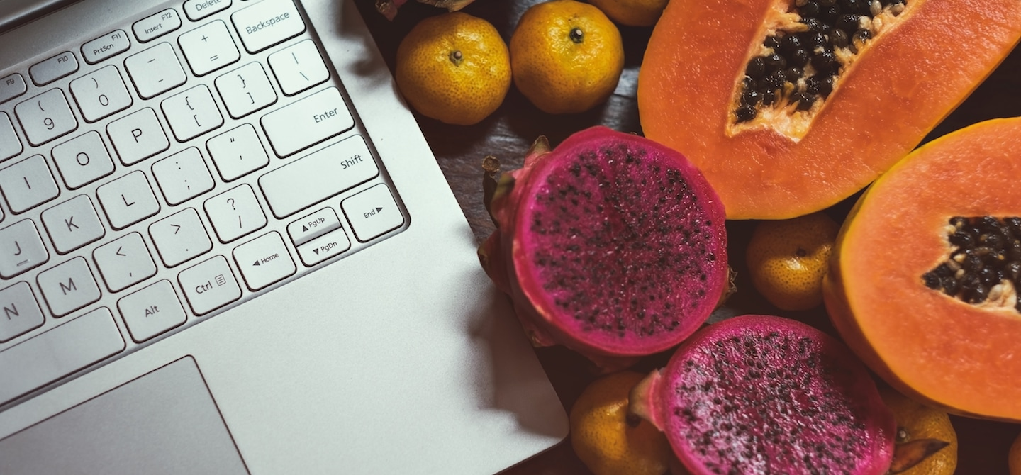 Super fruits next to laptop during a search of mosed googled diets