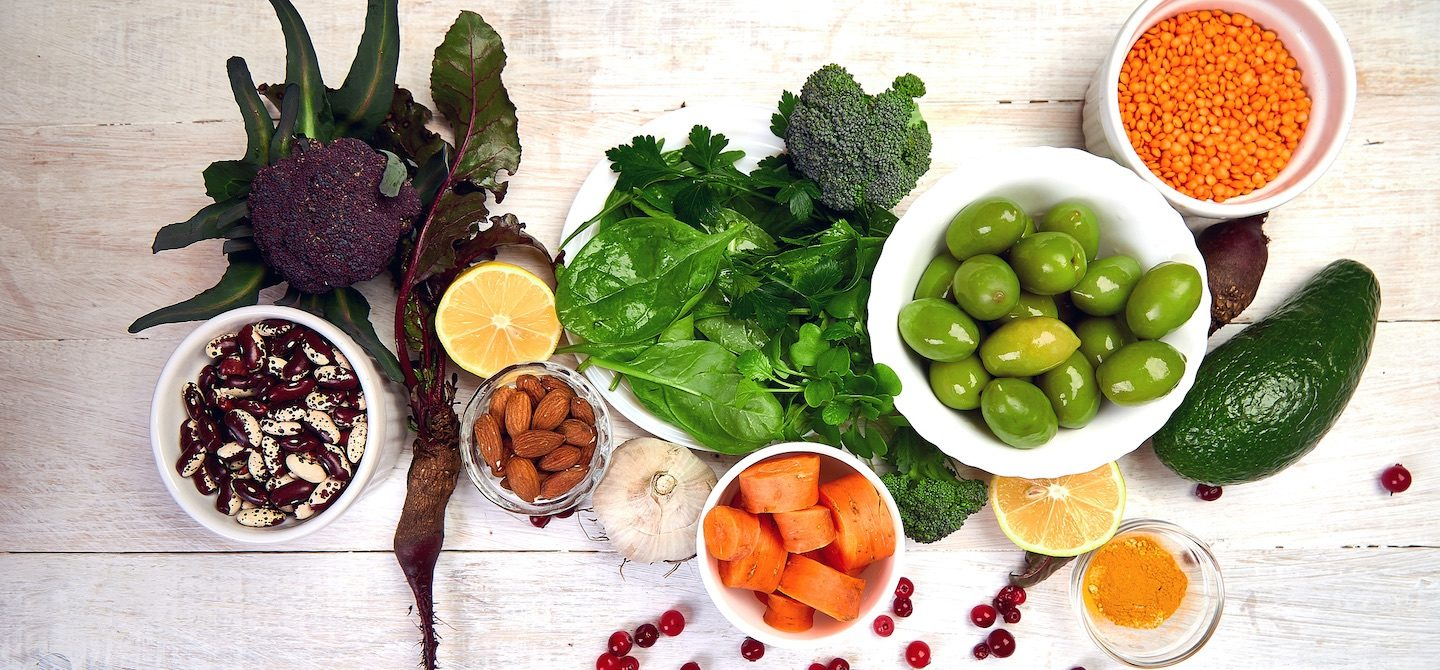 Best foods for liver detox diet, including greens, almonds, olives, and sweet potatoes