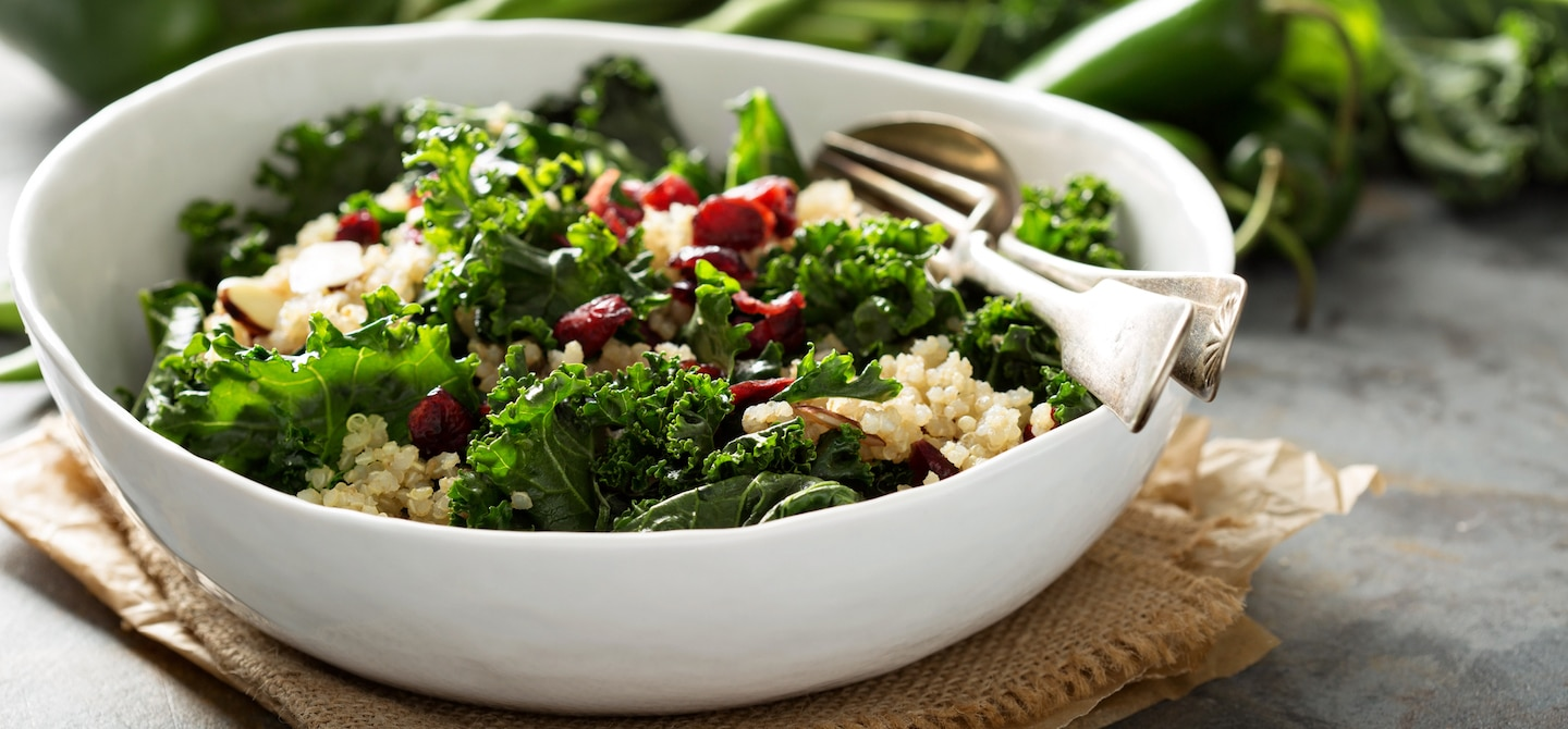 Anti-Inflammatory meal of kale and quinoa salad on nice tablescape