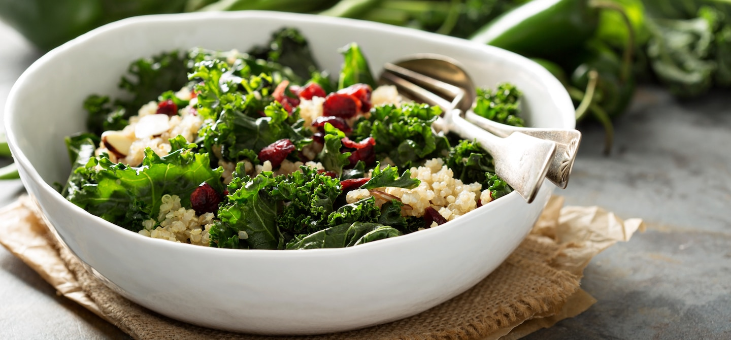 Kale and quinoa bowl, otherwise Healthy Foods That Cause Bloating