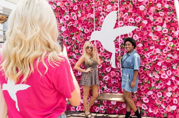 Girls taking photo at Rose Wall at HUM Together 2018