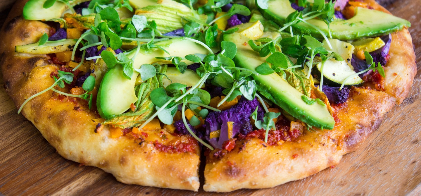 Veggie pizza with sprouts and avocado
