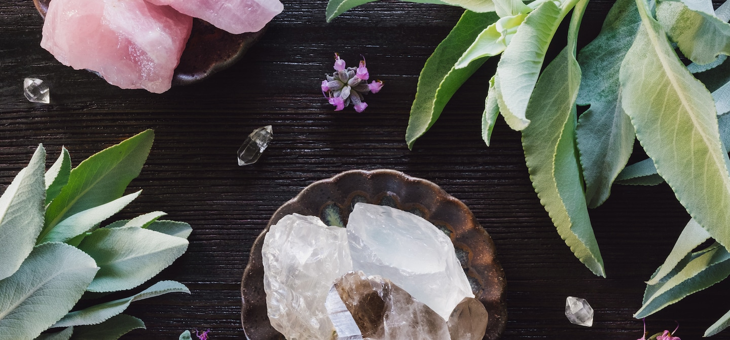 Crystals and plants on a pretty desk setting
