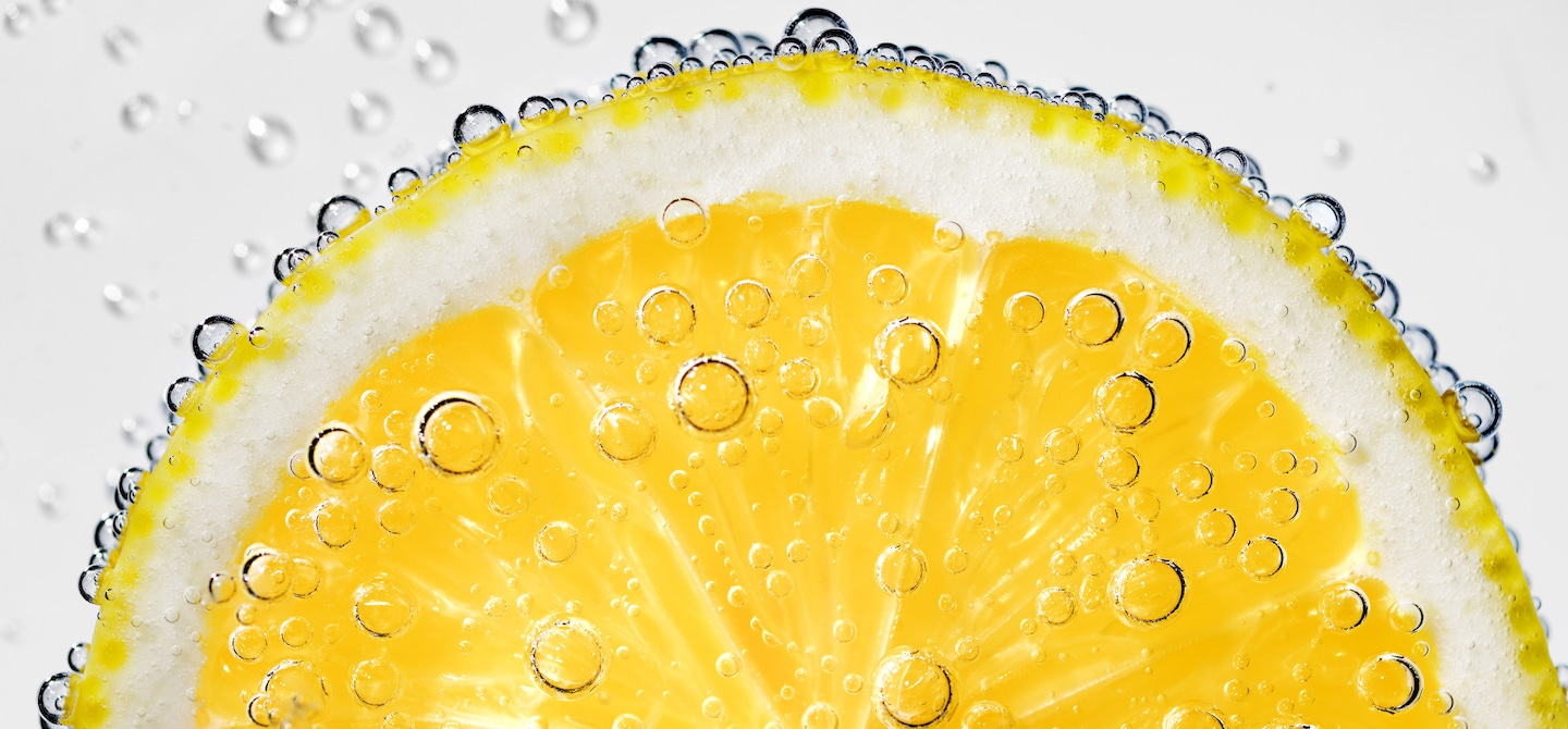 Lemon slice submerged in LaCroix sparkling water