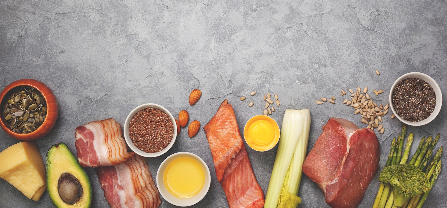 Keto diet foods including bacon, salmon, asparagus, cheese, and almonds