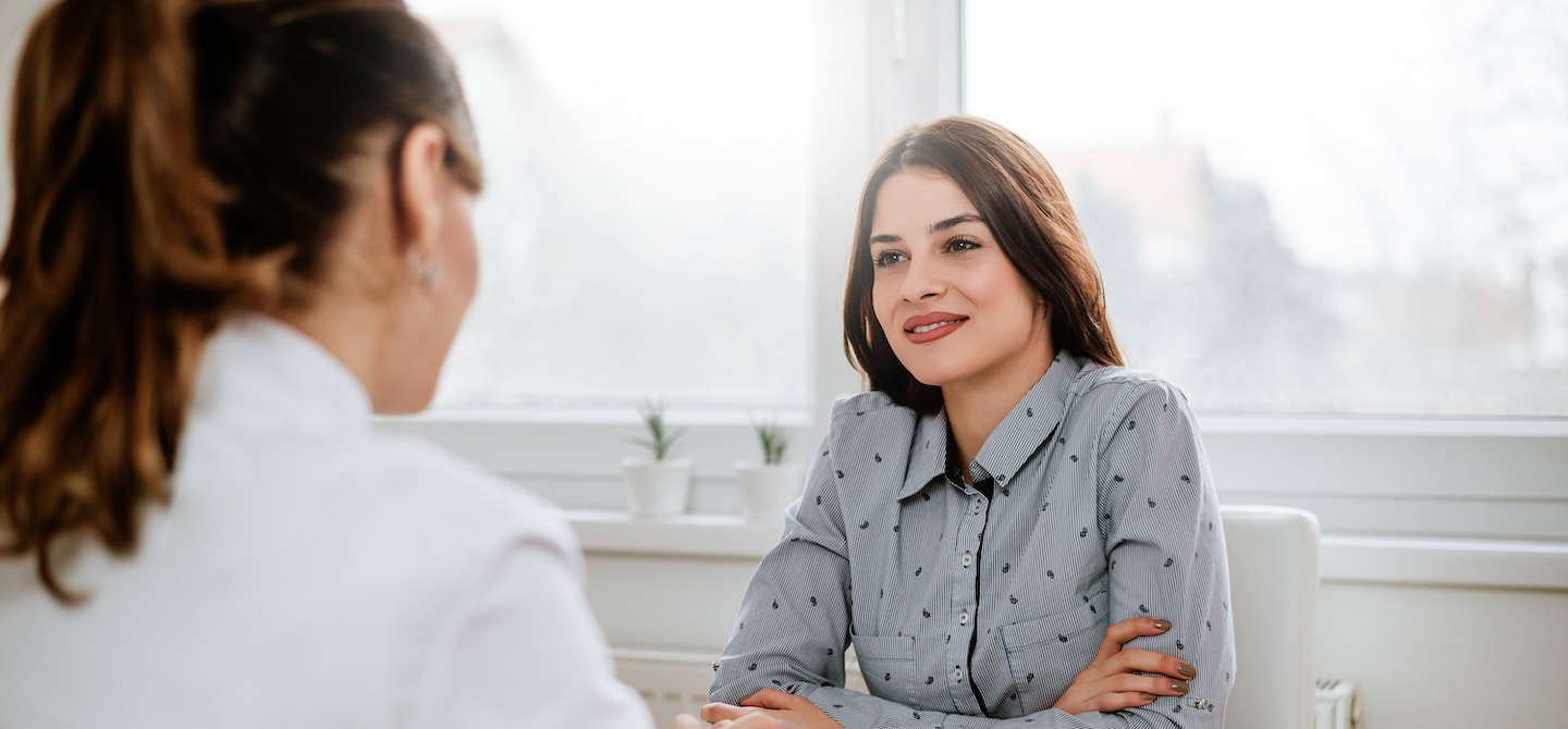 Woman speaking to her holistic gynecologist