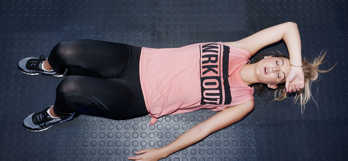 Woman passed out on floor after a Lagree Fitness workout