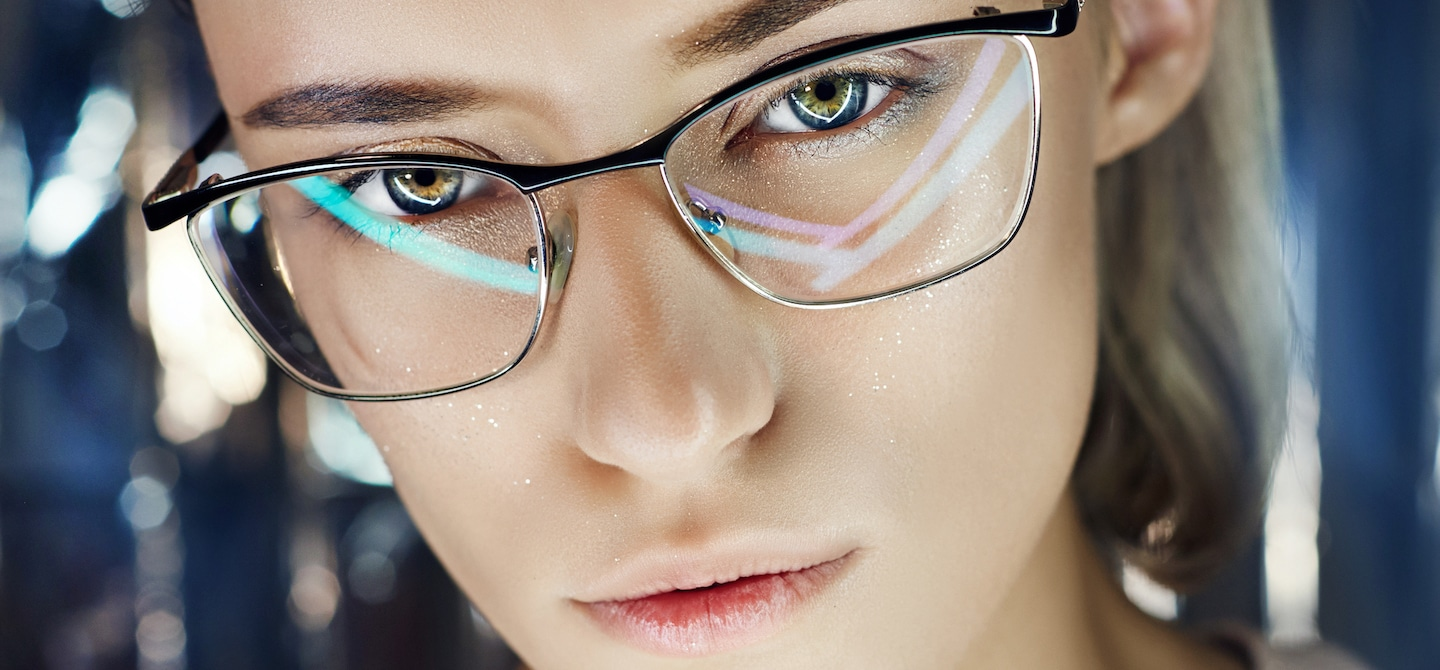 Woman wearing blue light glasses to protect from screen time