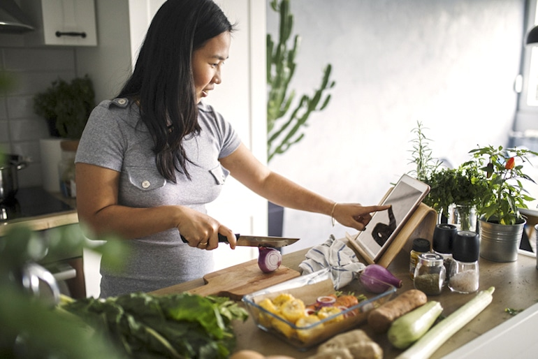 Woman following meal planning tips from a dietitian with her Trader Joe's groceries