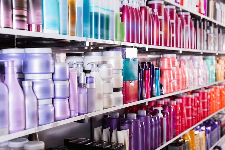 Aisle of hair care products in store