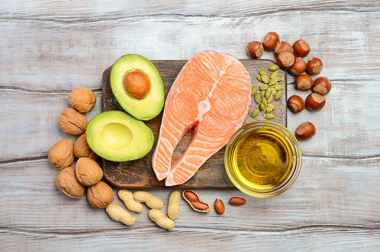 Salmon, avocado, nuts, and other sources of healthy fat to eat on a satiating diet