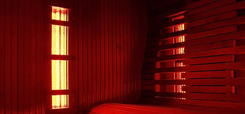Interior shot of infrared sauna with bench