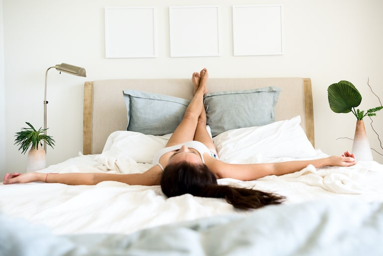 Woman relaxing at home to manage stres
