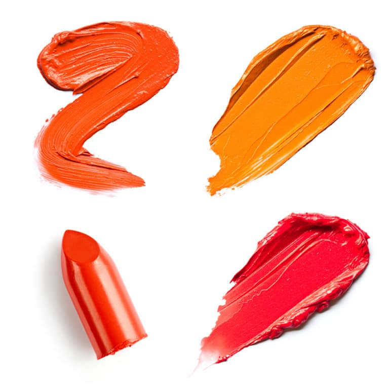 Red and orange lipstick smears for autumn
