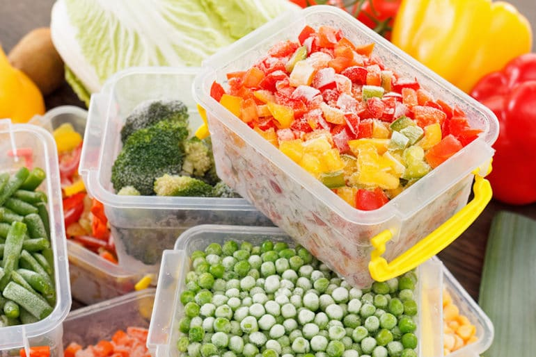 Frozen vegetables in microwave-safe containers