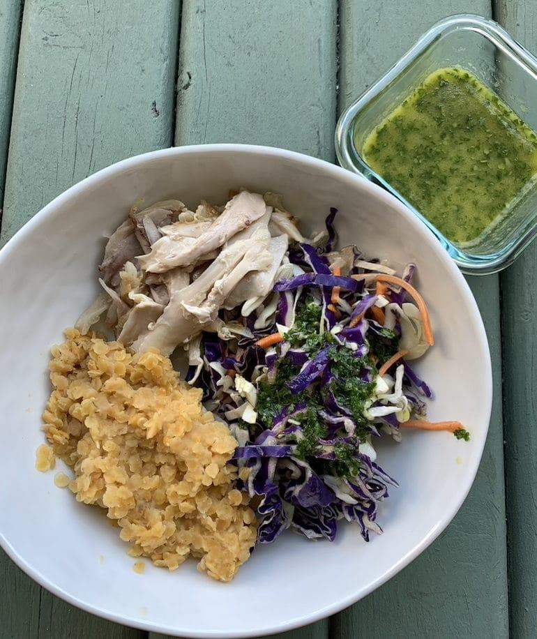 Rotisserie chicken, cole slaw with olive oil, lemon juice, cilantro, garlic and salt dressing, lentils