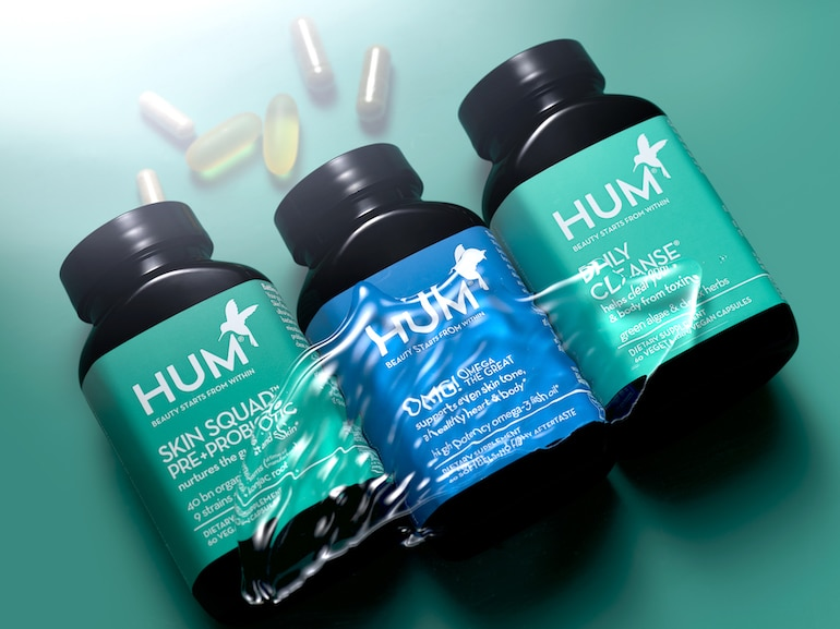 HUM supplements for clear skin - Skin Squad, OMG! Omega, and Daily Cleanse under water