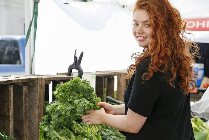 Health Chef Julia Chebotar shopping at a farmer's market