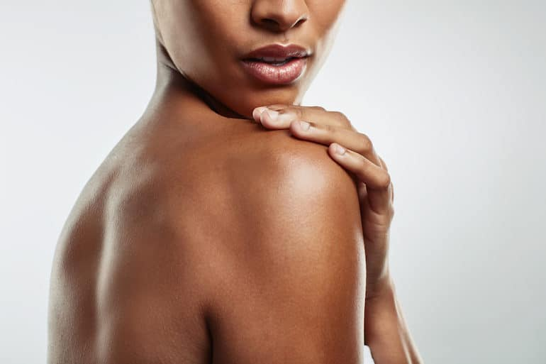 Side shot of a woman with glowing skin and a healthy skin barrier