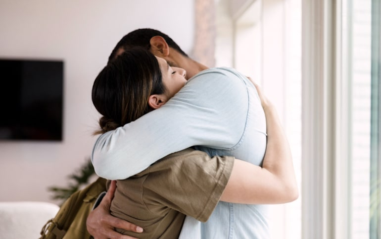 Couple embracing after talking about past wounds and healing