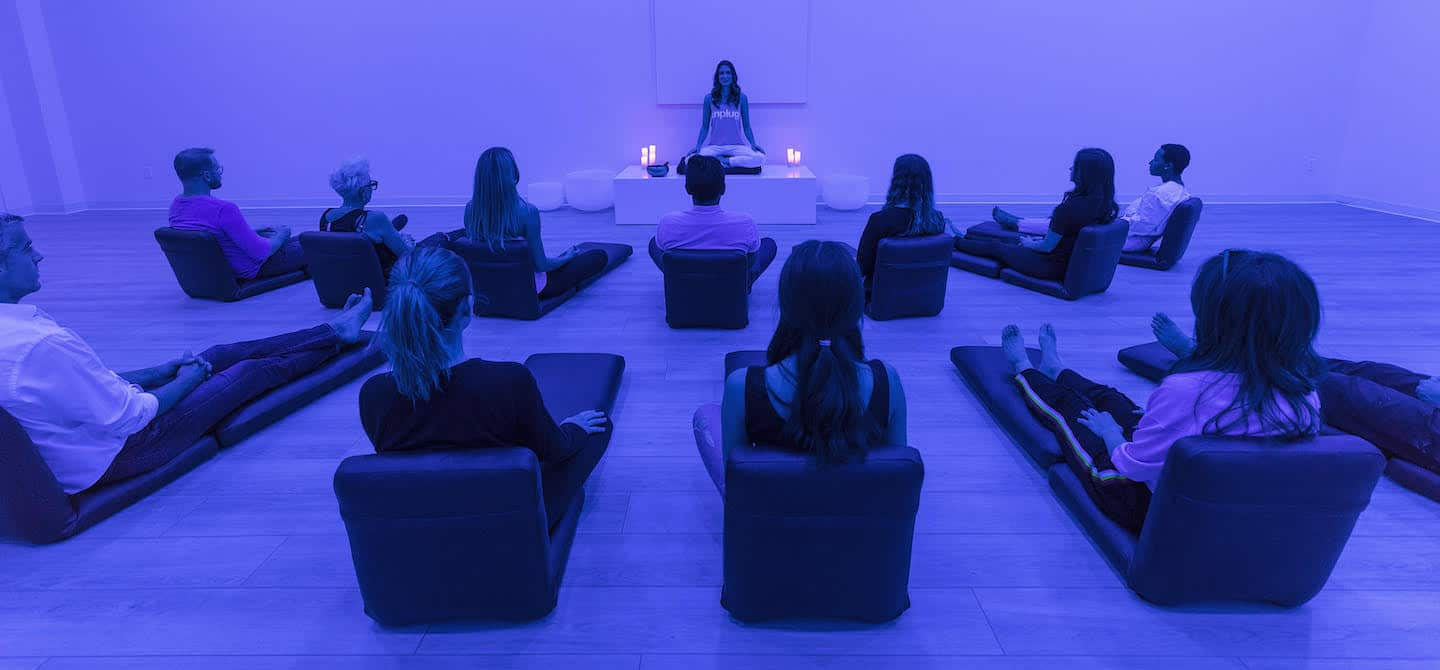 Meditation session with blue lighting at Unplug Meditation West Hollywood