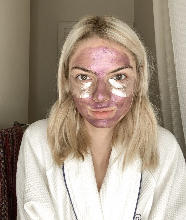 Actress Allie Marie Evans with Wander Beauty Face Mask and Baggage Claim Gold Eye Masks