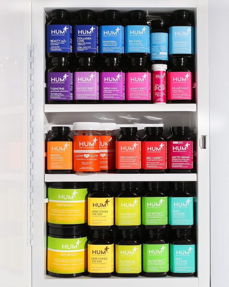 Bathroom shelf full of colorful HUM supplements