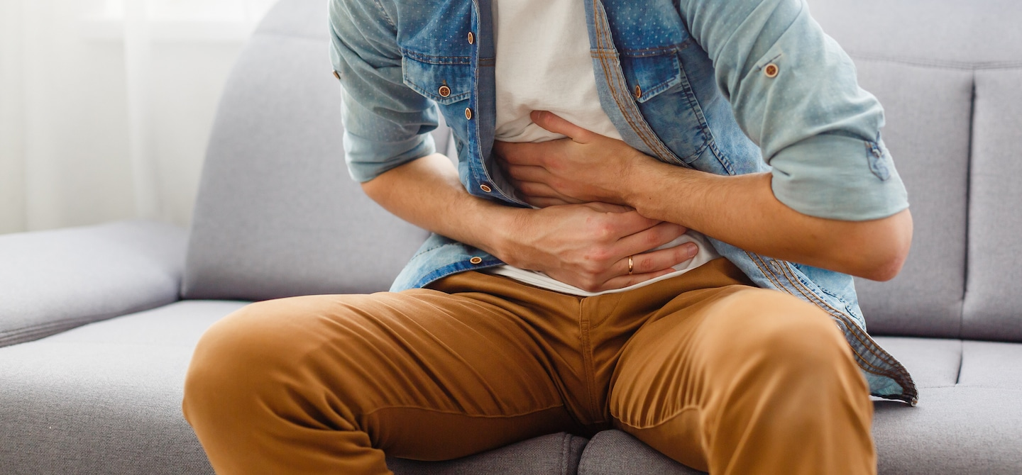 Man feeling leaky gut symptoms