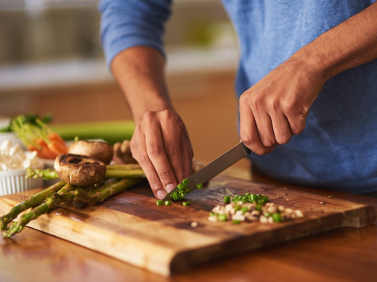Man cooking at home as new years resolution to cook more