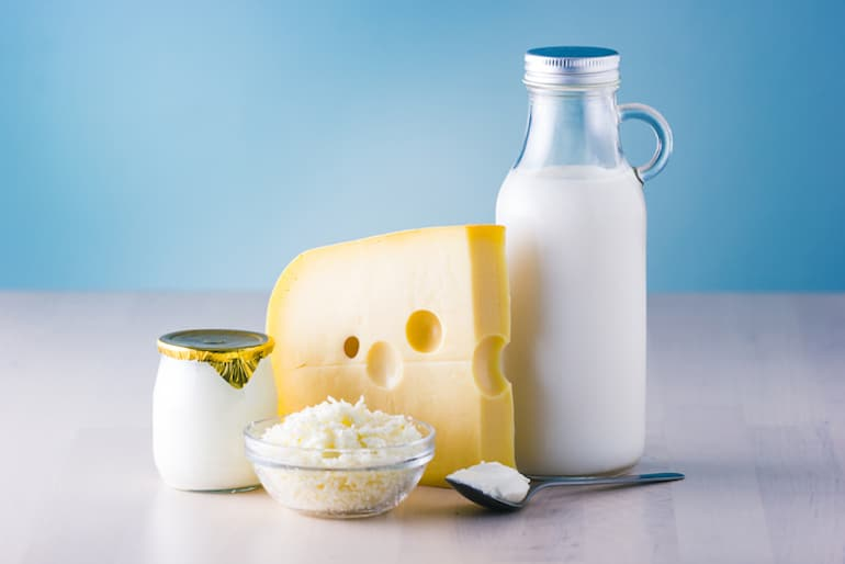 Dairy products, including cheese, milk, and yogurt, are foods to avoid for clear skin