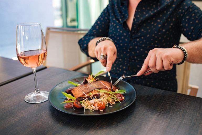 Man eating salmon, a D3 rich food