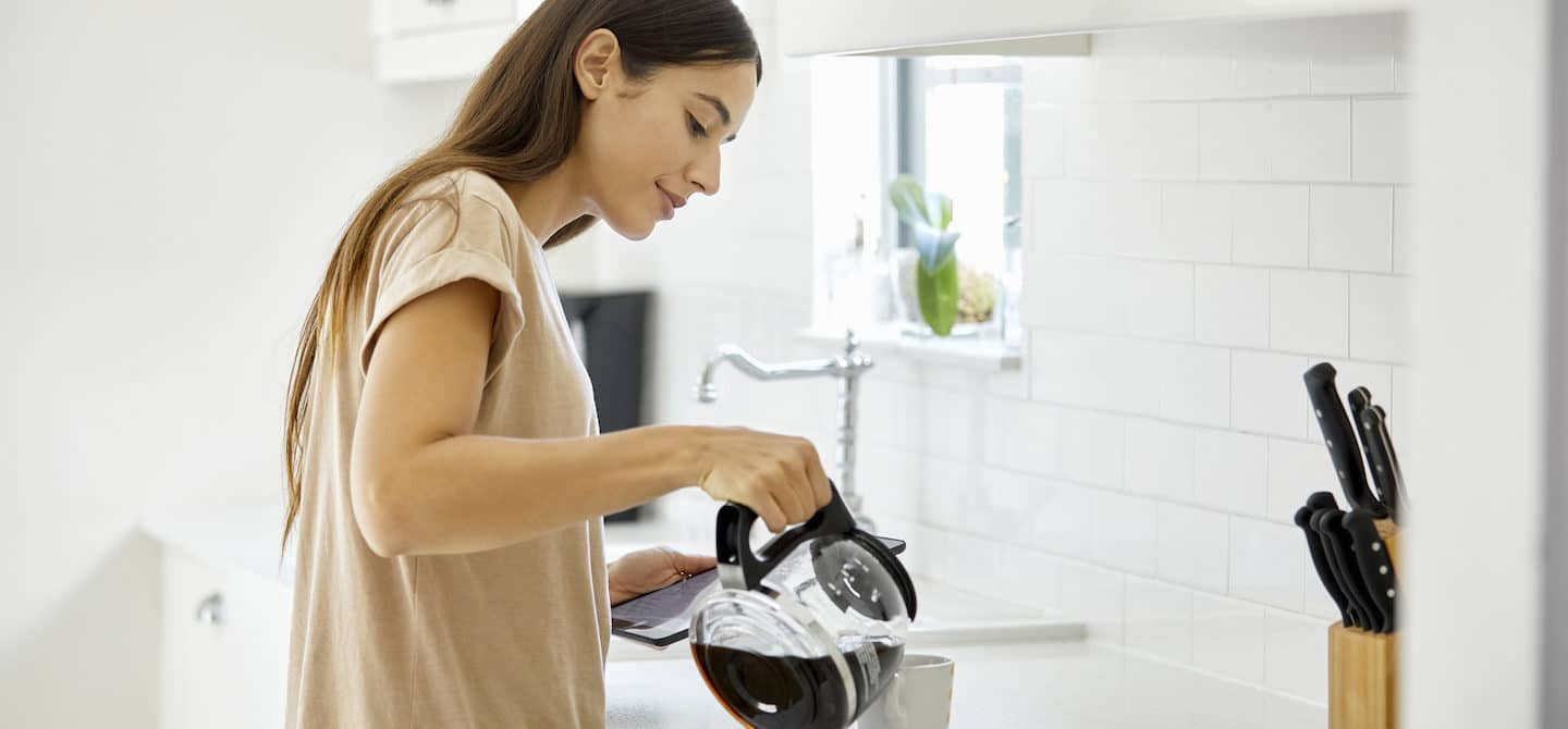 Woman pouring second cup of coffee from pot