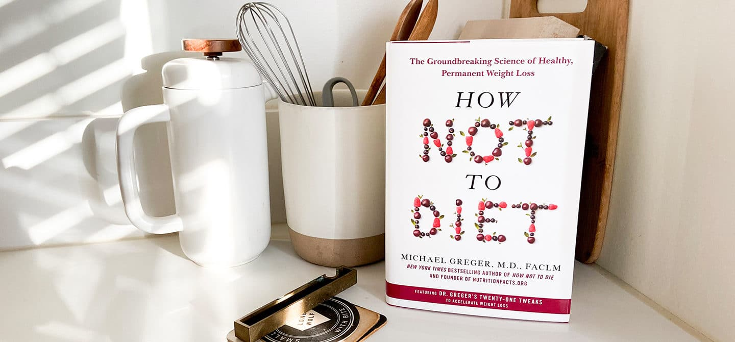 How Not to Diet book by Dr. Michael Greger in kitchen