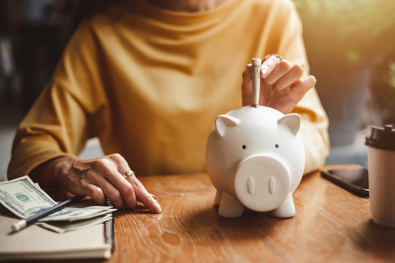 Woman saving money for new year's resolution
