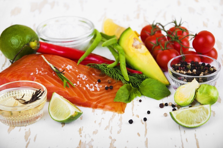 Anti-candida diet foods including salmon, avocado, extra virgin olive oil, and Brussels sprouts
