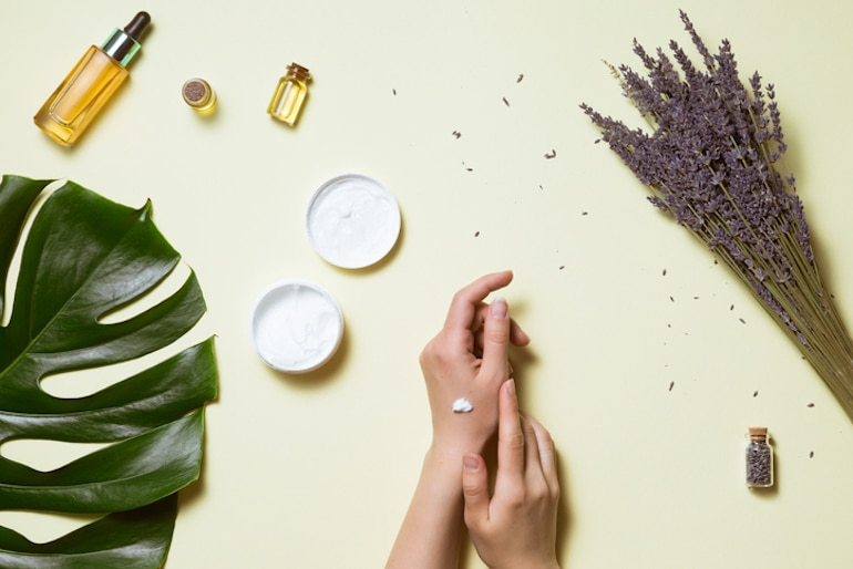 Woman patch testing plant-based skincare products on her hand