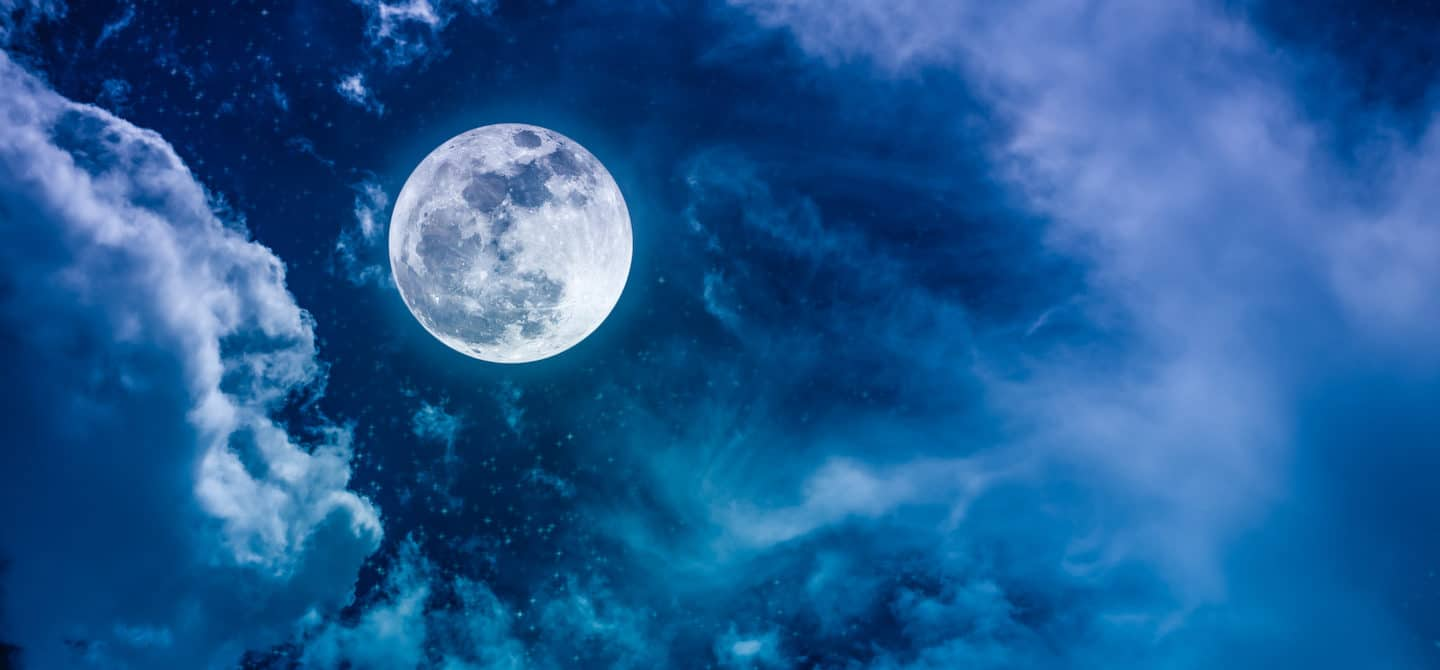 Blue and purple night sky with full moon